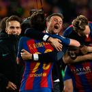 Barcelona coach Luis Enrique and Sergi Roberto celebrate after the game