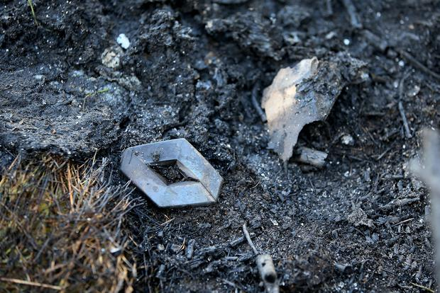 A Renault badge pictured at Beechlawn Grove where a van which was burnt out (Image: Frank Mc Grath)