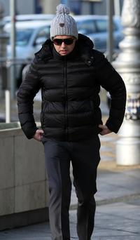 Jonathan Gill (35) of Malahide Road, Coolock, Dublin, arrives at the Dublin Circuit Criminal Court where he pleaded not guilty to falsely imprisoning a post office worker, his partner and their daughter in Drogheda between August 1 and 2, 2011. Pic Collins Courts.