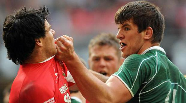 Mike Phillips clashes with Donncha O'Callaghan in the 2009 Six Nations (Getty)