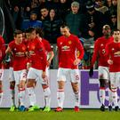 Manchester United's Henrikh Mkhitaryan celebrates scoring their away goal with team mates. Reuters / Grigory Dukor Livepic