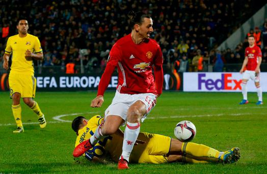 FC Rostov's Aleksandru Gatcan in action with Manchester United's Zlatan Ibrahimovic. Reuters / Maxim Shemetov
