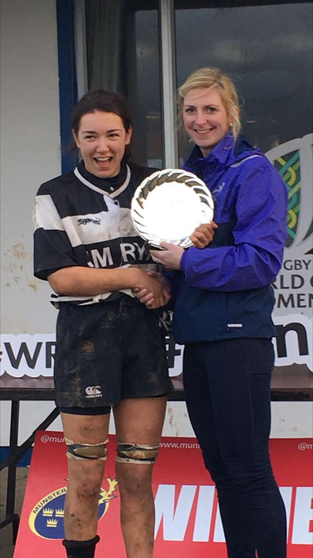 U-18 captain Jane Ryan is presented with the Munster Plate following victory over Shannon RFC