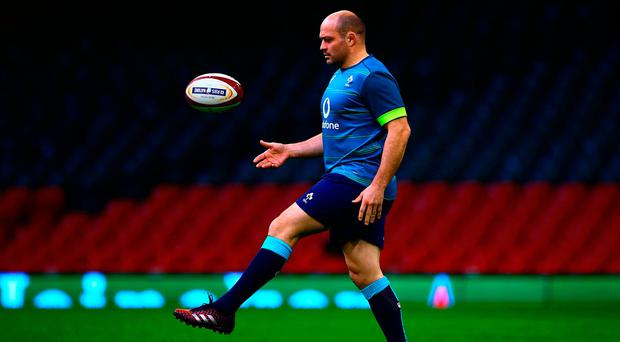 Ireland's Rory Best puts his best foot forward during the Captain's Run at the Millennium Stadium yesterday. Photo: AFP/Getty Images