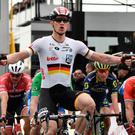 Andre Greipel celebrates as he crosses the line to win the fifth stage of Paris-Nice. Photo: Getty Images