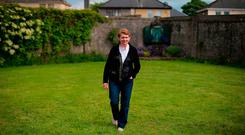 Historian Catherine Corless at the site of a mass grave for children who died in the Tuam mother and baby home. Photo: Niall Carson