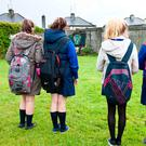 Local schoolgirls pay their respects at the site of the mothers and babies home unmarked grave in Tuam, Co Galway. Photo: Andy Newman. Photo: Andy Newman
