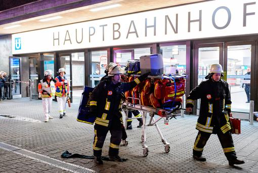 Police and emergency workers stand outside the main railway station following what police described as an axe attack on March 9, 2017 in Dusseldorf, Germany. (Photo by Alexander Scheuber/Getty Images)