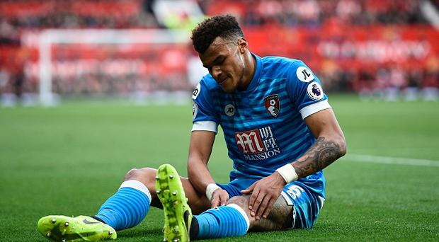 Bournemouth's English defender Tyrone Mings lies injured during the English Premier League football match between Manchester United and Bournemouth at Old Trafford in Manchester, north west England, on March 4, 2017. / AFP PHOTO / Oli SCARFF