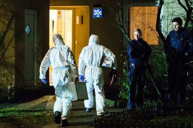 Forensic scientists enter a house in Herne, Germany (Marcel Kusch/dpa via AP)