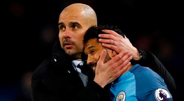 Pep Guardiola with Gael Clichy after the scoreless draw against Stoke this week - Guardiola's attacking philosophy has left City vulnerable to being hit on the break according to Richard Dunne. Photo: Phil Noble/Reuters