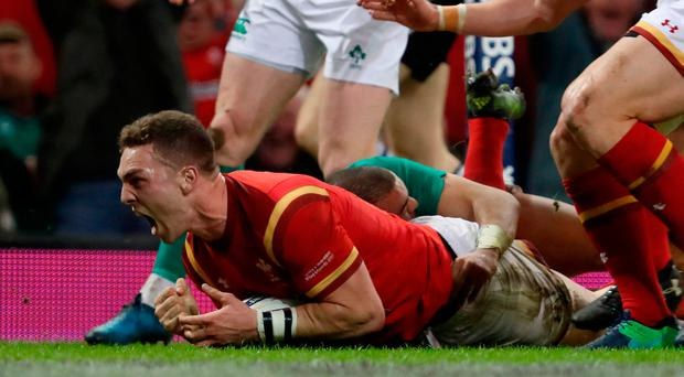Wales' George North celebrates scoring their first try