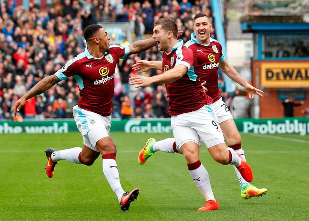 Burnley's Sam Vokes (left) celebrates scoring a goal with Andre Gray and Stephen Ward during their 2-0 win against Liverpool last August. Photo: Reuters / Lee Smith