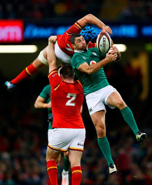 Rob Kearney challenges Wales' Justin Tipuric in the air during last night's Six Nations clash at the Millennium Stadium in Cardiff. Photo: Michael Steele/Getty Images
