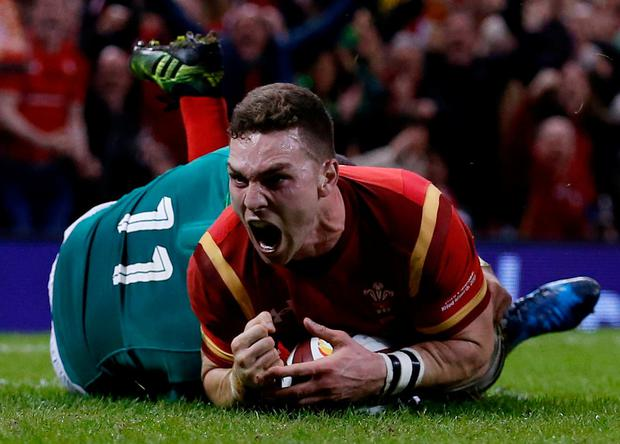 George North celebrates scoring the first of his two tries against Ireland in the Six Nations showdown in Cardiff last night. Photo: Andrew Boyers/Action Images via Reuters