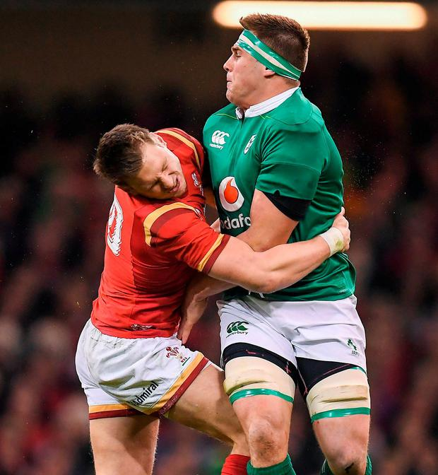 Ireland's CJ Stander is tackled by Dan Biggar of Wales during the Six Nations clash in Cardiff last night. Photo: Brendan Moran/Sportsfile