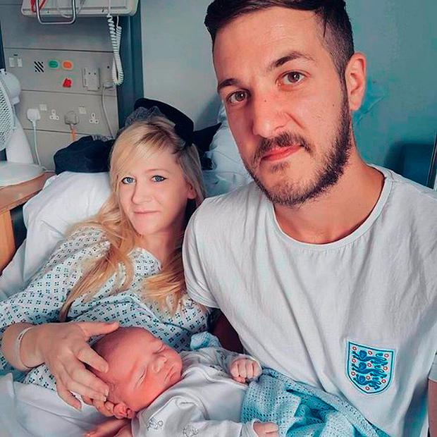 Charlie Gard with his parents Connie Yates and Chris Gard. Credit: Family handout/PA Wire