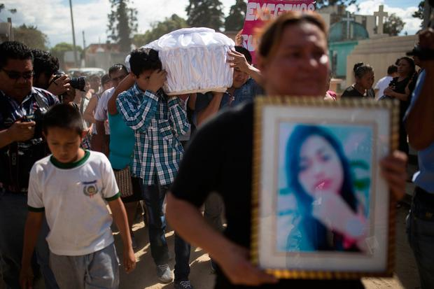 Relatives carry the coffin containing the remains of 17-year-old Siona Hernandez Garcia, a girl who died in a fire at the Virgin of the Assumption Safe Home, at the Guatemala City's cemetery (AP Photo/Luis Soto)