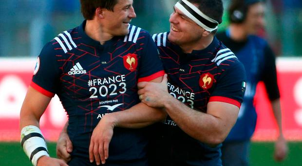 France's Francois Trinh-Duc celebrates with Guilhem Guirado at the end of the match
