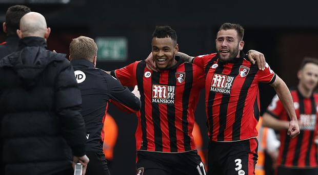 Bournemouth's Norwegian striker Joshua King (C) celebrates with Bournemouth's English defender Steve Cook (R) Bournemouth won the game 3-2. / AFP PHOTO / Adrian DENNIS