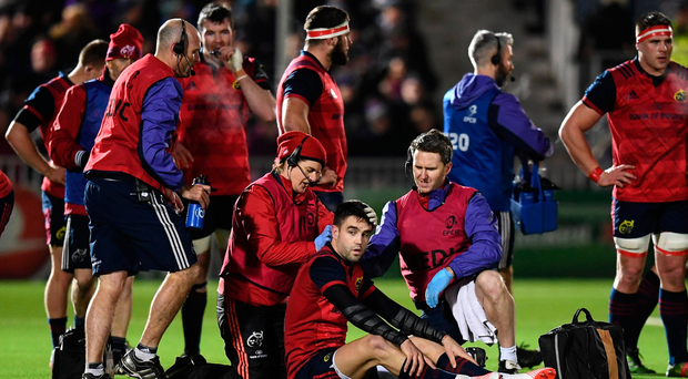 Munster's Conor Murray is assessed after suffering a head knock against Glasgow in the Champions Cup in January. Photo: Stephen McCarthy
