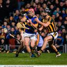 Sean Curran of Tipperary in action against Conor O'Shea, right, and Jason Cleere of Kilkenny during the Allianz Hurling League Division 1A Round 4 match between Tipperary and Kilkenny at Semple Stadium in Thurles, Co. Tipperary. Photo: McManus/Sportsfile