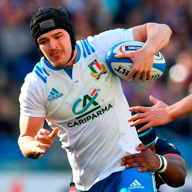 Italy's fly-half Carlo Canna escapes from a tackle during Italy's encounter with France in Rome. Photo: AFP/Getty Images
