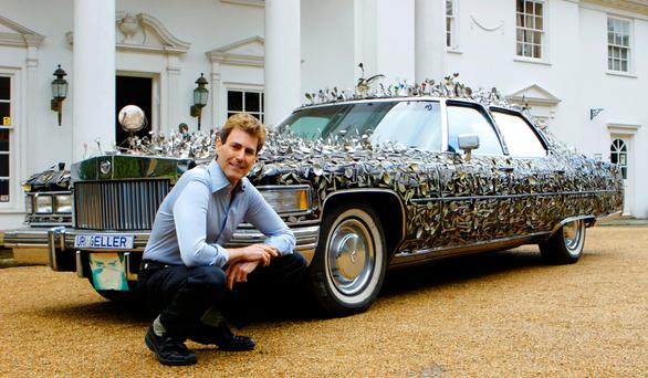 Cutlery king: Uri Geller with his Cadillac, covered in bent spoons once owned by every famous person he has met. 'I touched the Churchill spoon, looked into her eyes and told her she would be prime minister,' he says of his meeting with Theresa May