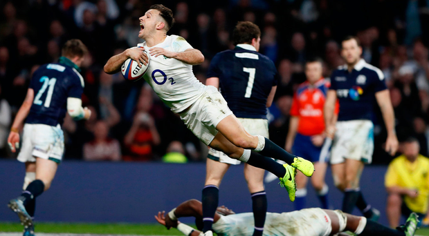 England's Danny Care leaps like a salmon as he scores his seventh try of the afternoon. Photo: Reuters