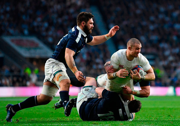 Mike Brown of England is tackled by Simon Berghan of Scotland in the big clash at Twickenham. Photo: Getty Images