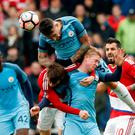 Manchester City's Nicolas Otamendi wins a header above team-mate Kevin De Bruyne and Middlesbrough's Marten de Roon. Photo: Reuters