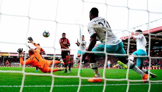 Joshua King of Bournemouth (partially obscured left) scores the winning goal. Photo: Getty