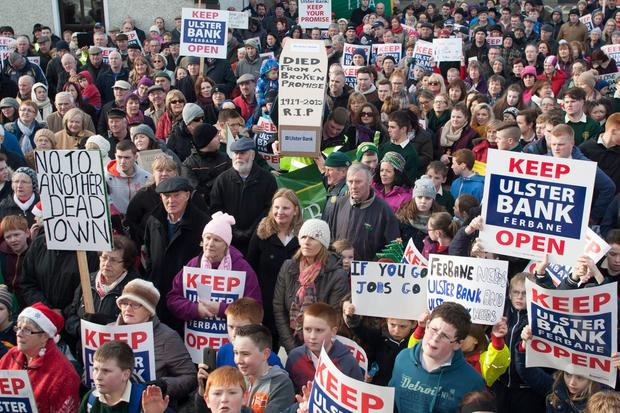 Protesters march against the closure of the Ulster Bank in Ferbane, Co Offaly — many rural towns have seen their banks and post offices close branches