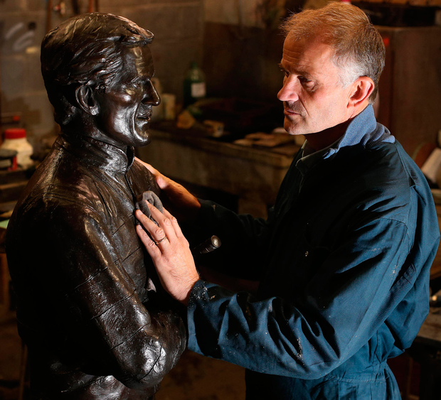 Paul Ferriter with his sculpture of jockey, Tony McCoy. Photo: Damien Eagers