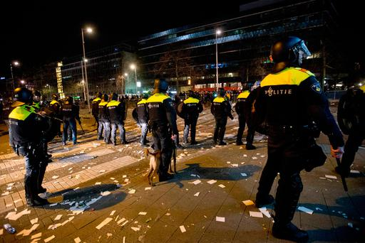Dutch riot police take up positions after riots broke out outside the Turkish consulate in Rotterdam, Netherlands (AP Photo/Peter Dejong)