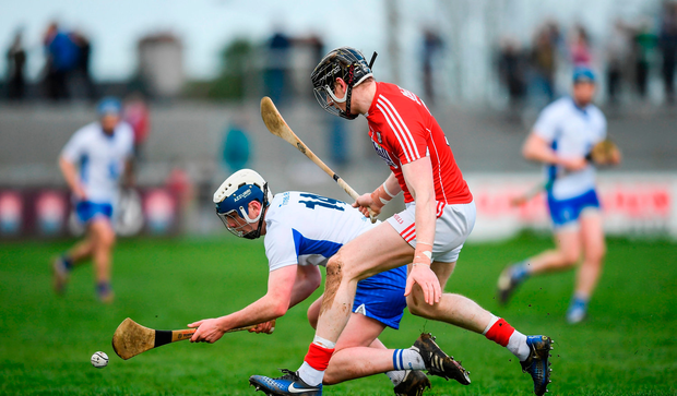 Stephen Bennett of Waterford in action against Damian Cahalane of Cork