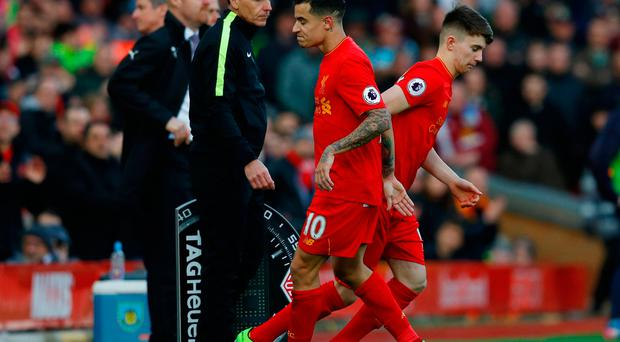 Liverpool's Ben Woodburn comes on as a substitute to replace Philippe Coutinho