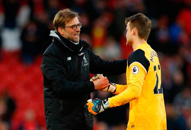 Liverpool manager Jurgen Klopp and Simon Mignolet celebrate after the game