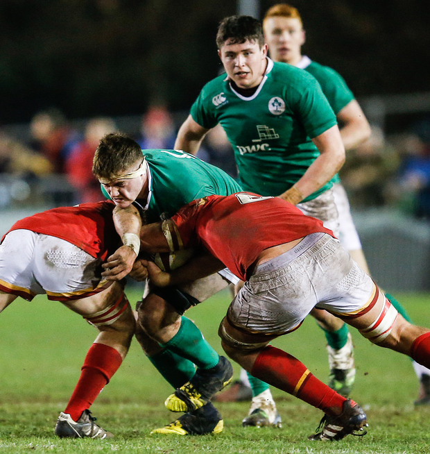 Ireland's Oisin Dowling is tackled by Aled Ward of Wales during the U20 Six Nations match. Photo: Simon Bellis/Sportsfile