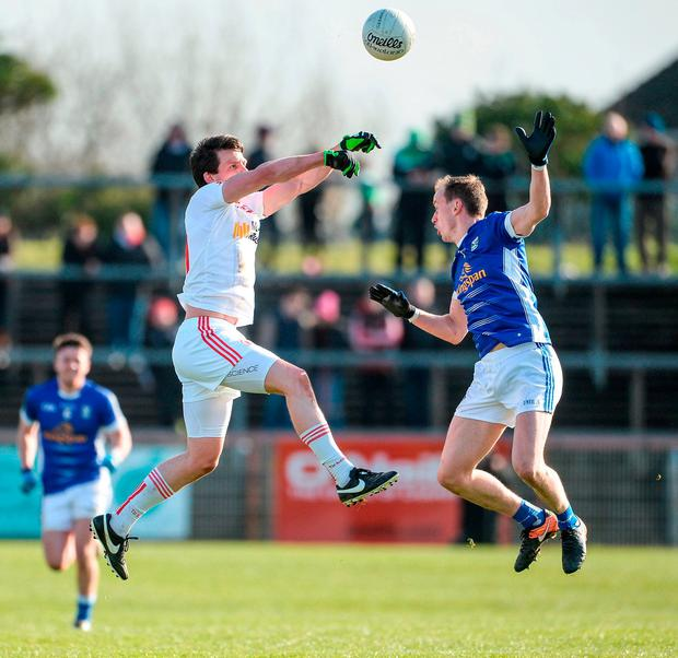 Aidan McCrory and Martin Reilly compete in the air. Photo: Oliver McVeigh/Sportsfile