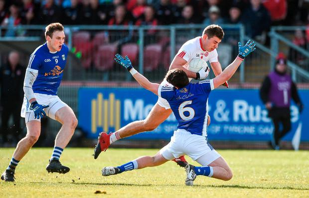 Cavan's Conor Moynagh tries to close down Padraig McNulty. Photo: Oliver McVeigh/Sportsfile
