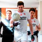 Sean Cavanagh leads the Tyrone team out