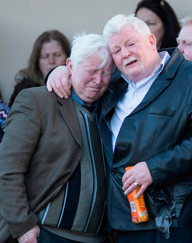 Grandparents of the children who died in the Clondalkin blaze, John (black jacket, pictured) and Bridie O'Brien are consoled at the removal of their grandchildren's remains yesterday Picture: Mark Condren