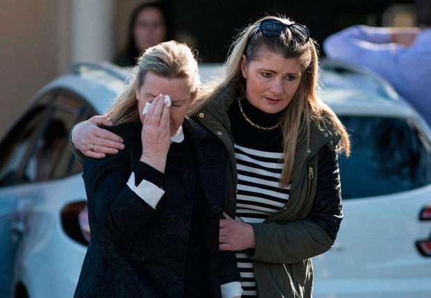 Mourners are overcome by grief at the funeral home in Bray Picture: Mark Condren