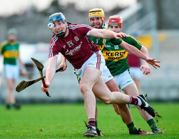 Conor Cooney is closely pursued by Kerry's John Buckley and Keith Carmody. Photo: Diarmuid Greene/Sportsfile