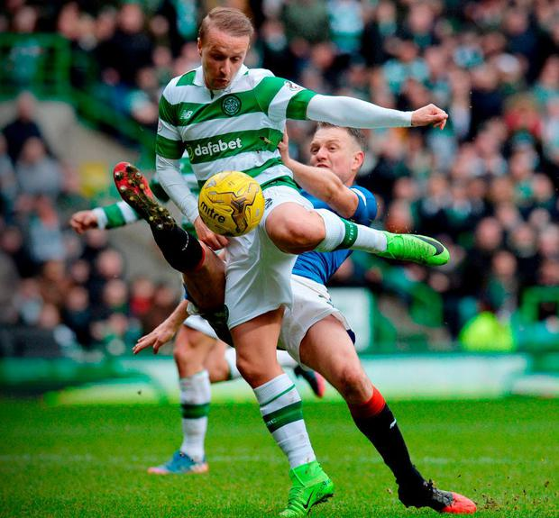 Celtic's Leigh Griffiths is tackled in the penalty box by Rangers' Clint Hill during their Scottish Premiership match at Celtic Park yesterday. Photo: Mark Runnacles/Getty Images