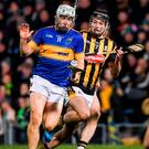 Kilkenny's Jason Cleere gives chase after Tipperary's Niall O'Meara during Saturday's NHL Division 1A clash at Semple Stadium. Photo: Ray McManus/Sportsfile