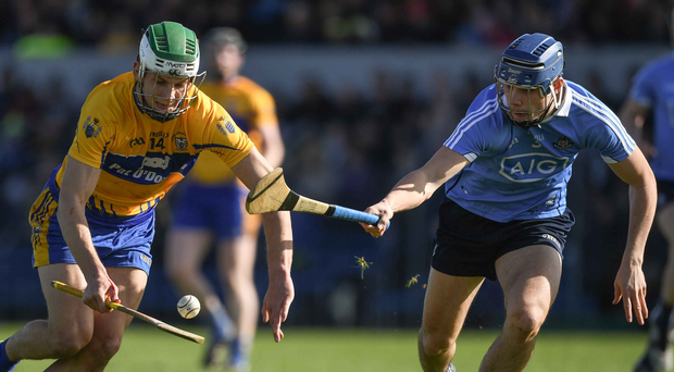 Clare's Aron Shanagher wins possession ahead of Dublin's Eoghan O'Donnell. Photo: Ray McManus/Sportsfile
