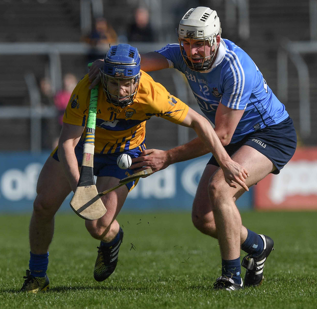 Clare's Podge Collins in action against Dómhnall Fox of Dublin at Cusack Park. Photo: Ray McManus/Sportsfile