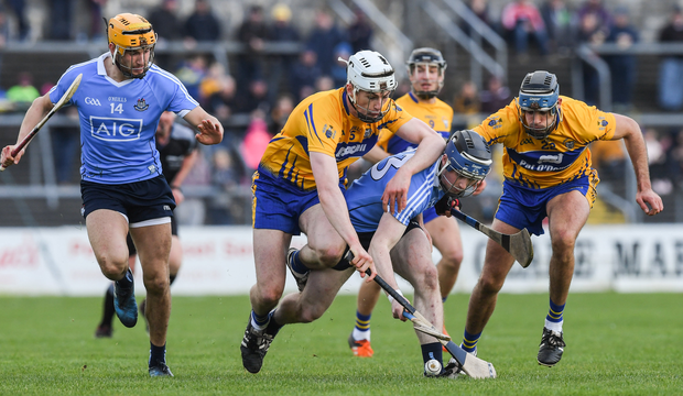 Fiontán McGibb and Eamon Dillon of Dublin in action against Conor Cleary and Brendan Bugler of Clare. Photo: Ray McManus/Sportsfile